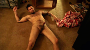 Jeremy St. James nude cock laying on the ground